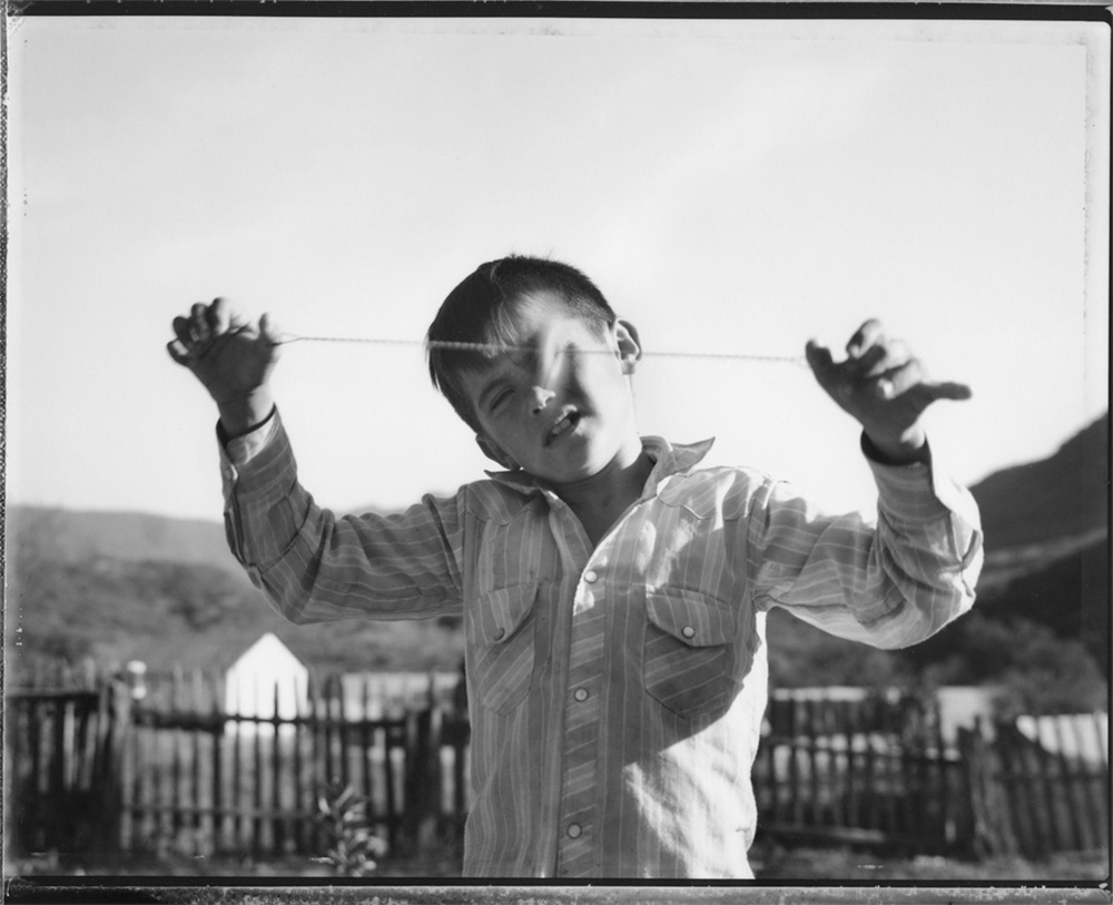 Boy watching spinning top, Guadalupe, remote village in the Sierra Madre, 1990