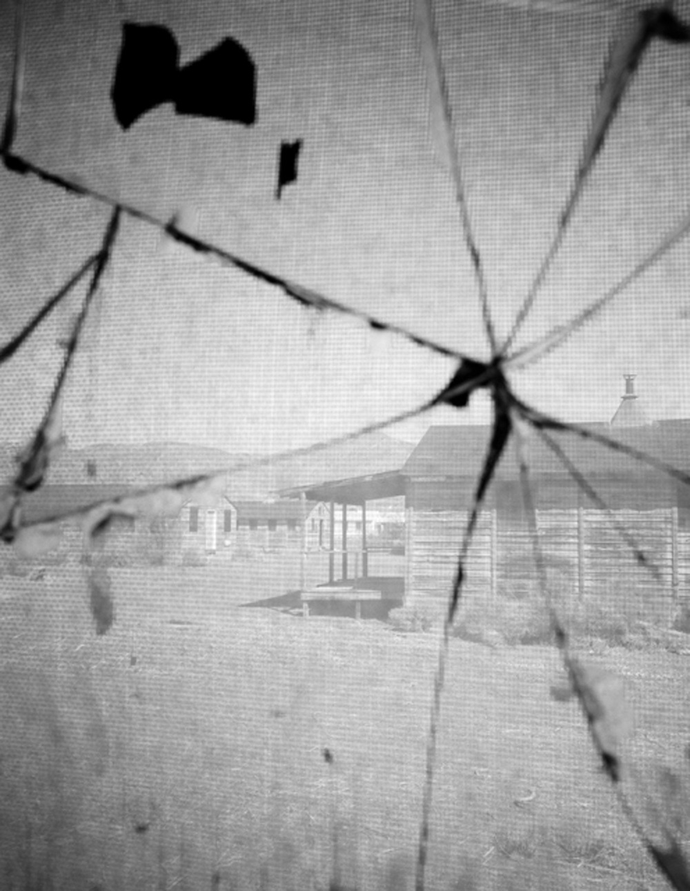 View through cracked glass, enlisted men's' barracks