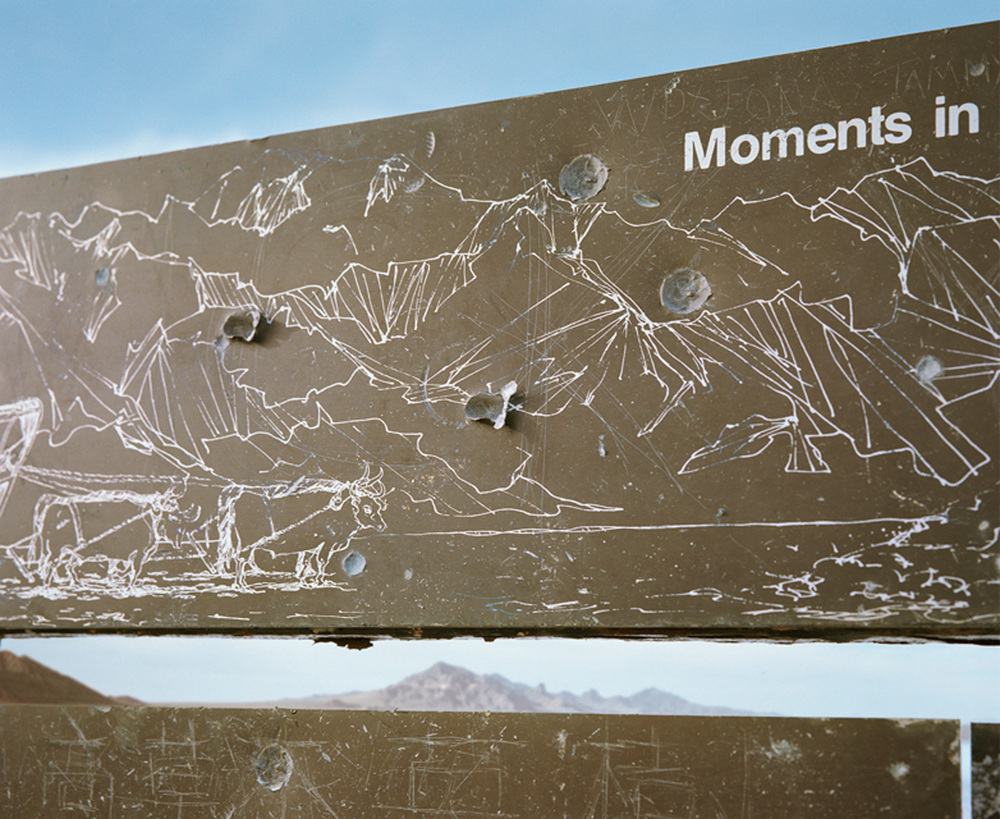 Interpretive sign hit by gunfire, Bonneville Salt Flats