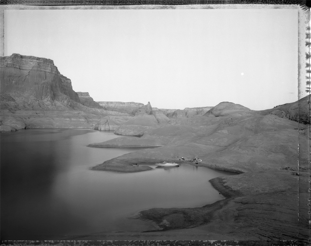 Campsite reached by boat through watery canyons, Lake Powell, 1983