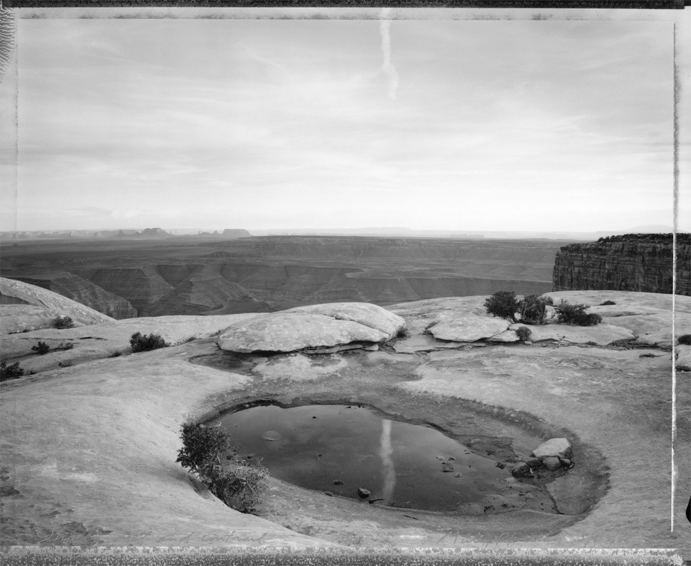 Small pool and contrail, Muley Point, Utah, 1988