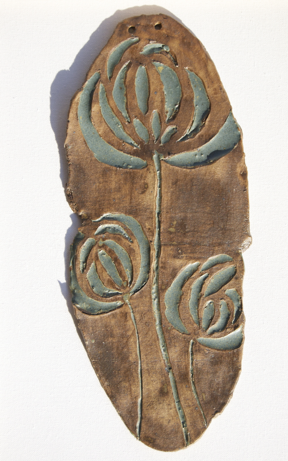"Ceramic Wall Decor: ""Leather and Iron Blue Flowers"""