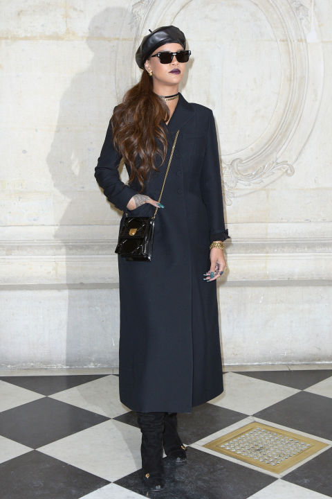 Rihanna in Paris for Paris Fashion Week, adds a little fashion flair to her look with her leather beret. Available at Net-a-porter.com