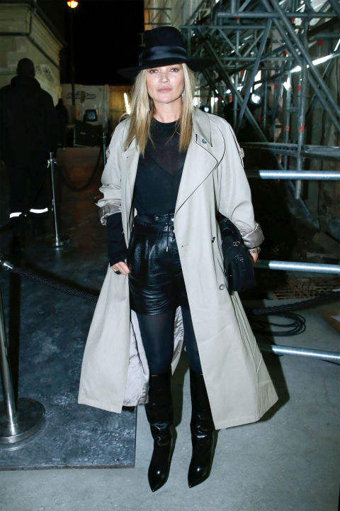 Kate Moss shows us you can look fabulous even when it rains in. As she wore an oversized trench and paired it with a natty black hat during Paris Fashion Week. Available at  Net-a-porter.com