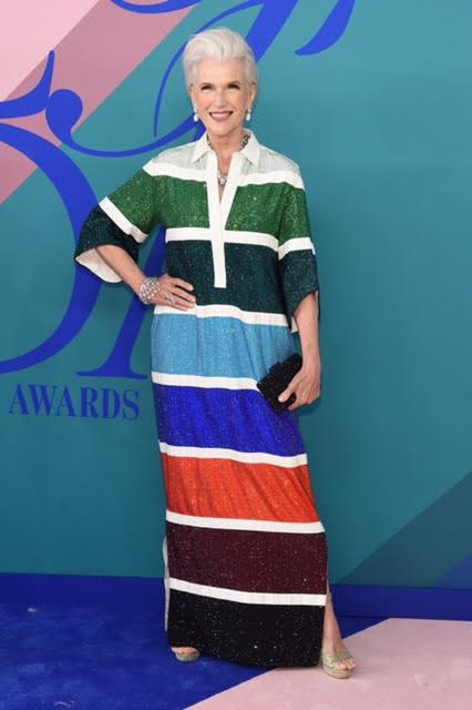 Maye Musk wearing Rosie Assoulin, Atelier Swarovski jewelry and an Onna Ehrlich bag.