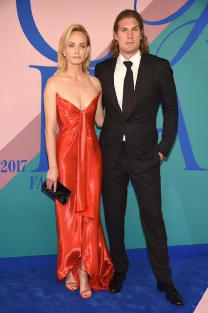Amber Valletta wearing Oscar De La Renta and a Tyler Ellis bag.