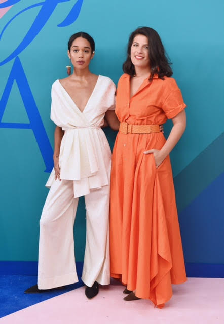 Rosie Assoulin and Laura Harrier wearing Rosie Assoulin.