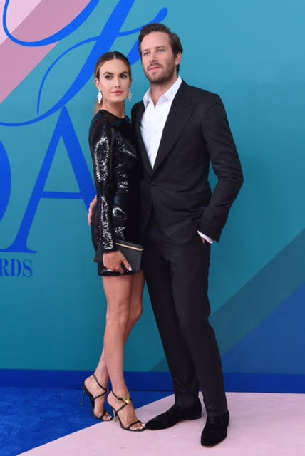 Elizabeth Chambers wearing Tom Ford and Armie Hammer wearing Tom Ford and Christian Louboutin shoes.