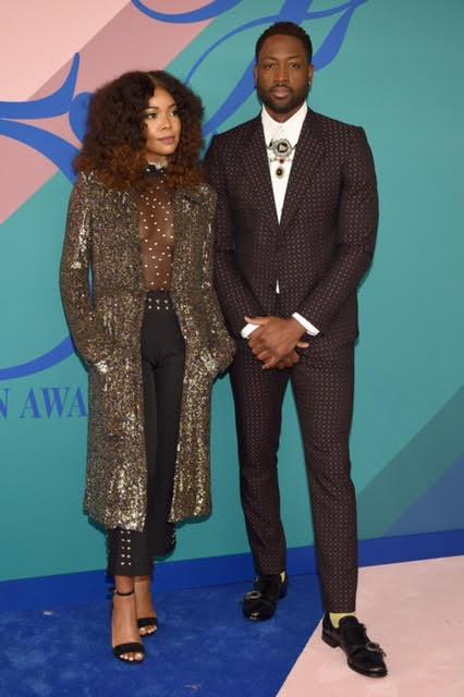 Gabrielle Union wearing Rodarte, Stella Luna shoes and Monique Pean jewelry. Duane Wade wearing Gucci.