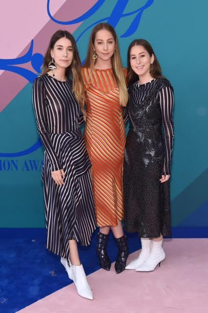 Danielle Haim, Este Haim and Alana Haim of Haim wearing Diane Von Furstenberg.