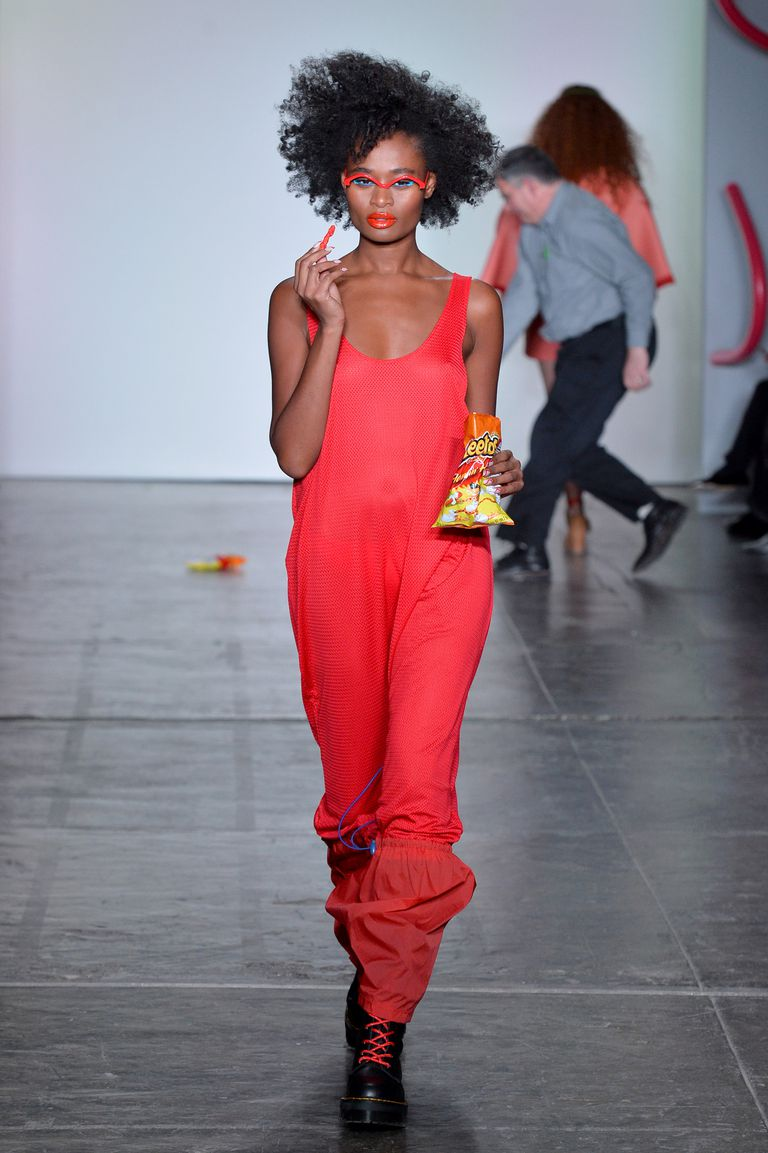 Another model who didn't have the luxury of bungee cord pockets simply made do and carried her bag of Cheetos like this season's hottest clutch.
