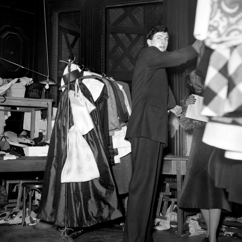 Hubert de Givenchy backstage at his Spring/Summer 1952 show