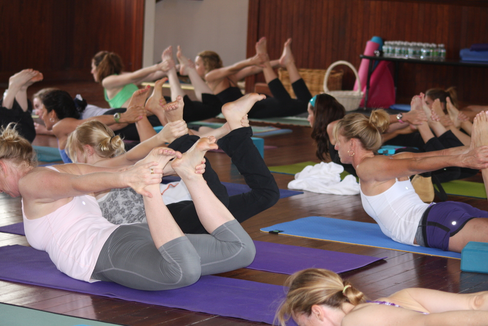 Yoginis in Dhanurasana. The Bow Pose