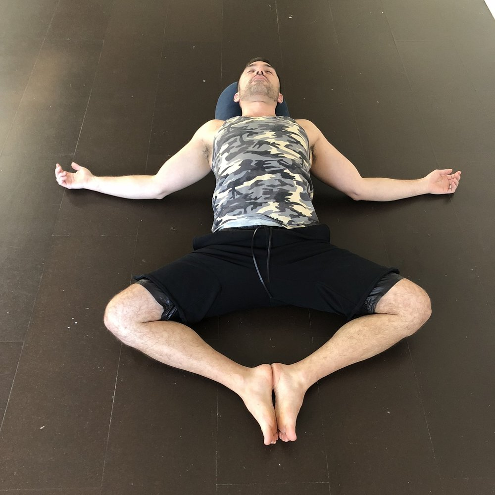 Bound Angle on a Bolster  - Come to a seat with a few pillows behind your back.  Bring the soles of the feet to touch, and allow the knees to fall wide. Slowly lay back on the pillows. Close your eyes and soften inward.  Stay until you feel called to move.