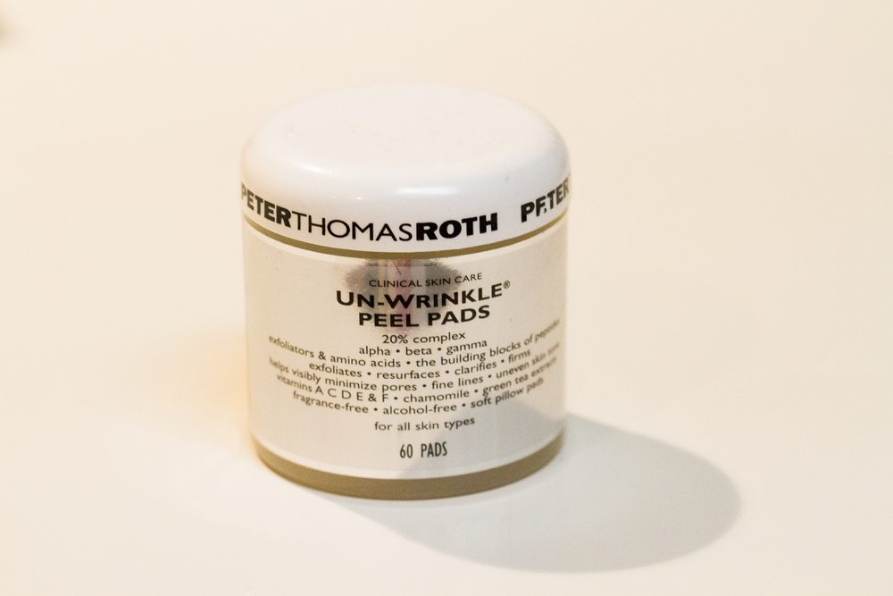 Peter Thomas Roth Un-Wrinkle Peel Pads ($45):  This is a higher end line so this peel is a little more on the expensive side. It does come with 60 peel pads though so I have made mine last about 3 months so far.  These are seriously amazing! This is a peel so you want to use them after you have cleansed your skin.  You will leave it on for around 2-5 minutes (depends on how your skin handles the peel) and then rinse well.  These will exfoliate, clarify and firm the skin.  In other words help minimize pores, fine lines and wrinkles and uneven skin tone.  See! I told you these were amazing! The peel is a 20% glycolic and lactic acid but also has chamomile and green tea extract to help calm the skin from the peel.  You can use this daily, but I choose to use it 1-2 times a week so I don't go through them to fast:)
