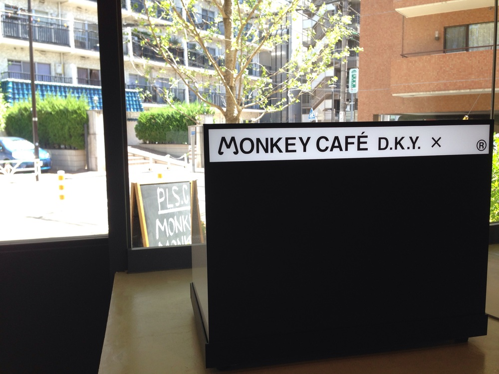 Minimalist logo of Monkey Cafe