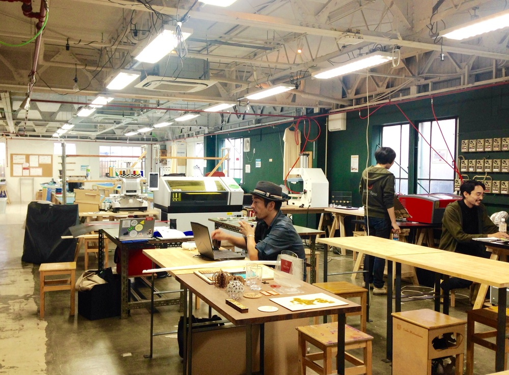Digital workspace equipped with laser, UV printers and leather sewing machines