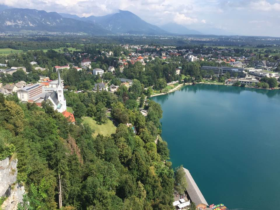 At the top of a massive hill we biked up, at a castle overlooking Lake Bled.