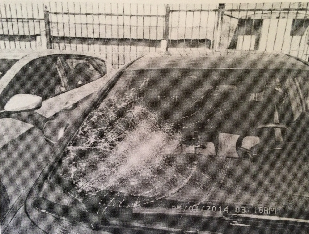 The image from the insurance report of the shattered windshield, caused by the impact of my body. April 22, 2014.