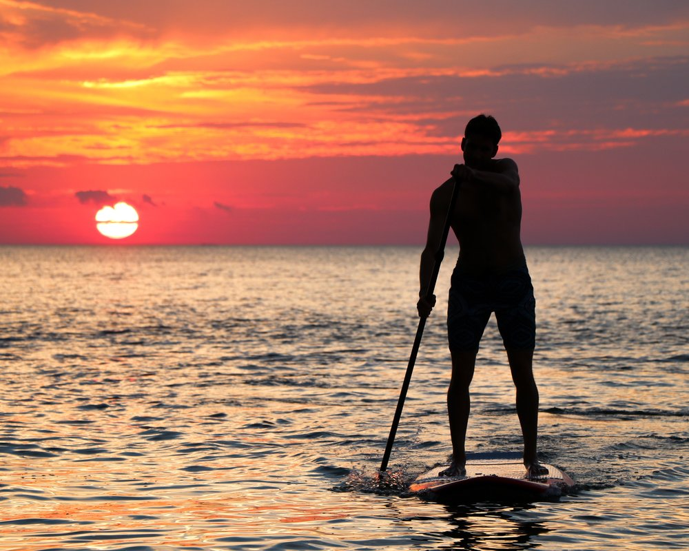 Paddleboarding into the sunset.