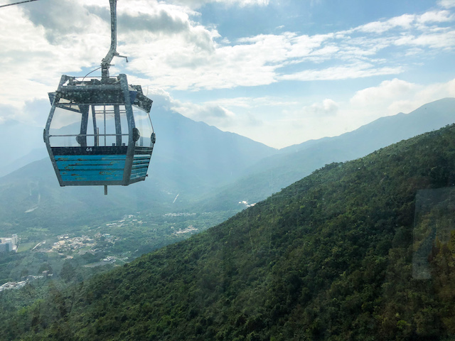 Riding the cable car, high above the mountains!