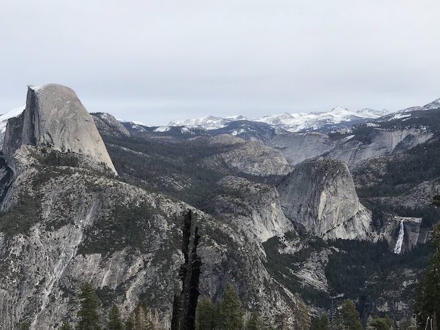 Half dome on the left, with the trail up to it visible in the middle of the image, Nevada falls on the right. This photo was taken on a clear winter day from the Panoramic trail a few years after the initial summit.