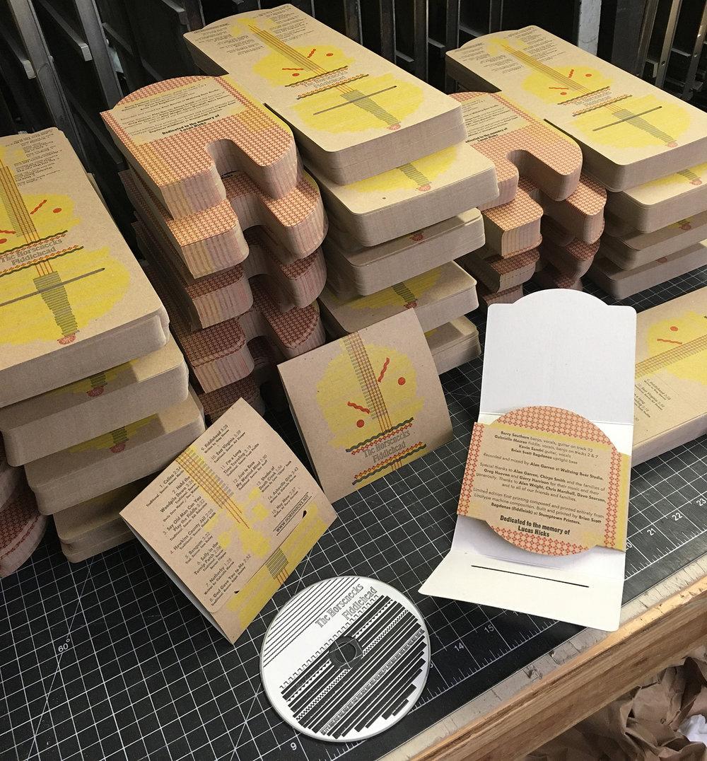 *Linotype Horsenecks Fiddlehead Die-cut stacks and CD 1 (LOW).jpg