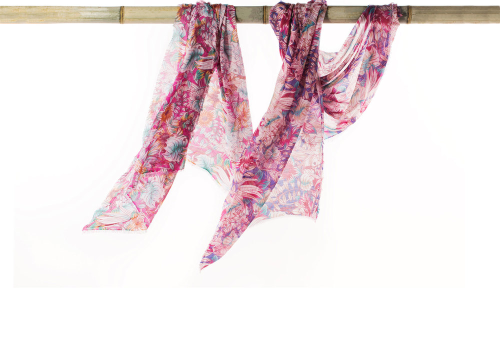 EXOTIC & TRANSPORTING   Take an island getaway with these tropical cashmere scarves.