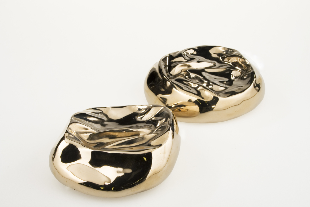 Inner Beauties, 2010 - silicone breast implants cast in polished bronze, edition of 5 pairs, diam. 12cm