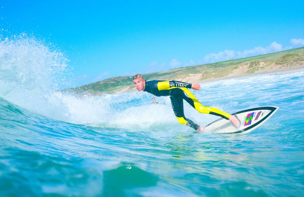 Surfing at Freshwater West, Pembrokeshire  (Crown copyright 2018 / Visit Wales)