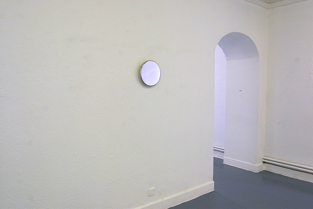 Double – two wall-mounted stainless steel disks on opposite walls facing each other  Double  - large disk   2003   stainless steel   29 x 2 cm installation view Butler Gallery, Kilkenny, Ireland, 2003