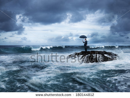 stock-photo-business-despair-man-with-an-umbrella-at-stormy-ocean-180144812_shutterstock.jpg