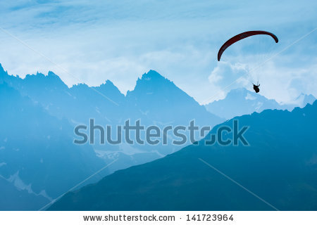 stock-photo-paraglide-shadow-figure-over-alps-peaks-141723964_shutterstock.jpg