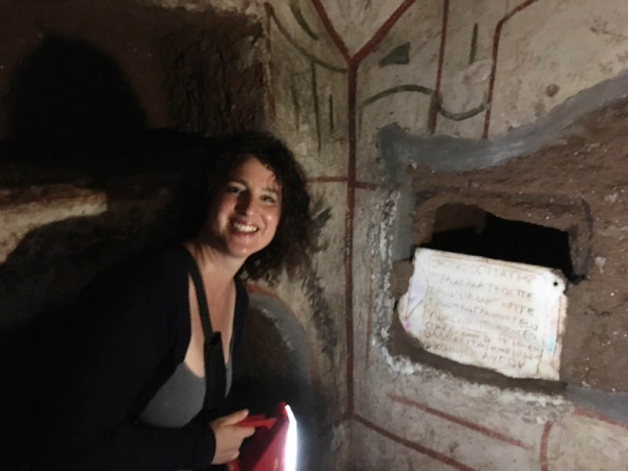 Jessica Dello Russo in a chamber in the Vigna Randanini catacombs, shedding light on an epitaph (not in situ) to Petronius the grammateus, son of Honoratus, also a grammateus, and Petronia (JIWE 2.223). The marble slab partially closes the square opening of a wall tomb. Photo: Steven Fine.