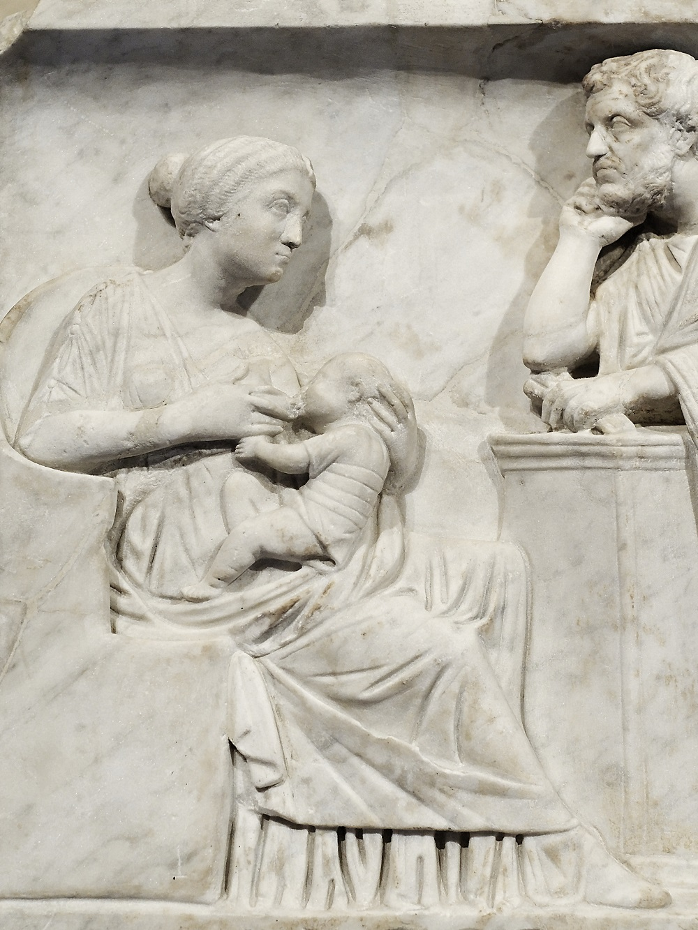 Detail of mother feeding child | Sarcophagus of Marcus Cornelius Statius, c.150CE, currently in the collection of the Louvre |  Image Source