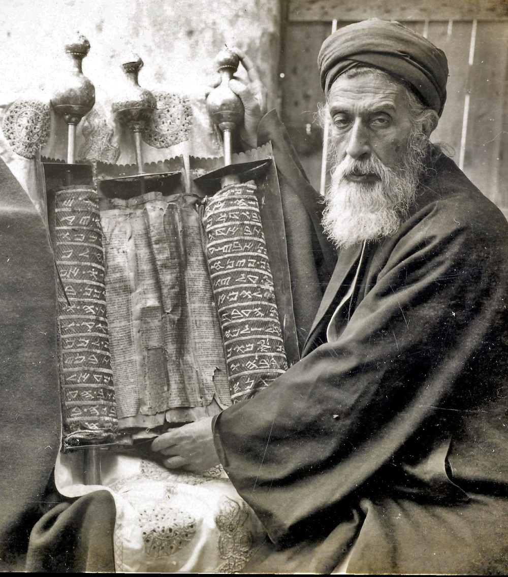 Yaakov ben Aharon, Samaritan High Priest (1896-1916), with a Samaritan Pentateuch | Part of a stereograph series from  Views of Palestine  (1905) |  Image source
