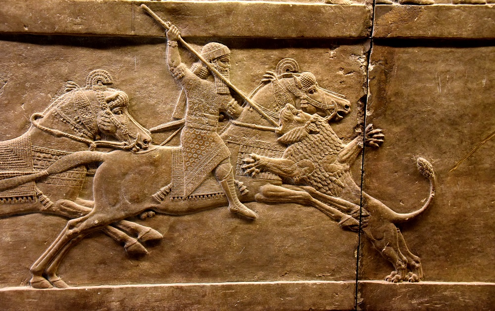 Neo-Assyrian bas-relief from Ninevah of Assyrian king Ashurbanipal slaying a lion | Currently housed in the British Museum, London |  Image Source