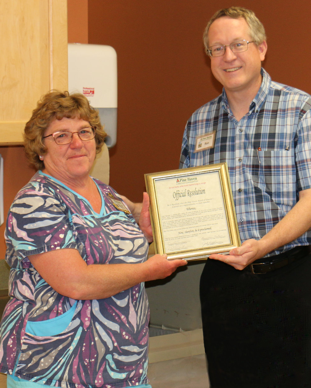 CEO Ron Walvoort, presents Joan with the official Board Proclamation of Joan Spindler Appreciation Day