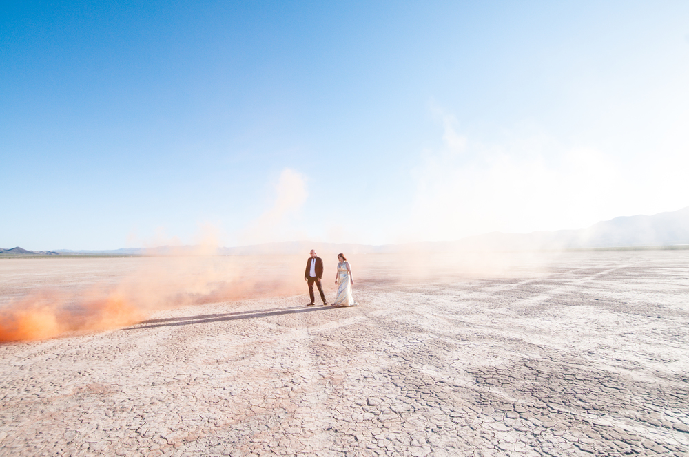 smoke bomb wedding, pop up wedding, elopement las vegas, las vegas elopement, smoke bomb elopement, elope in vegas, las vegas, dry lake bed, orange smoke bomb