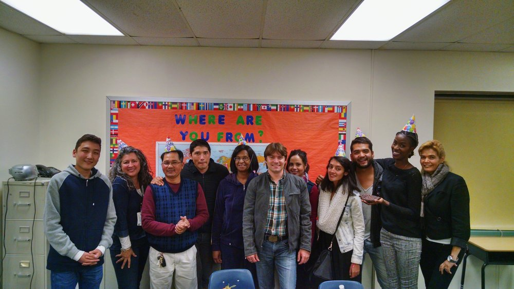 Celebrating a Newport News Adult Education ESL class celebrating a student's birthday.