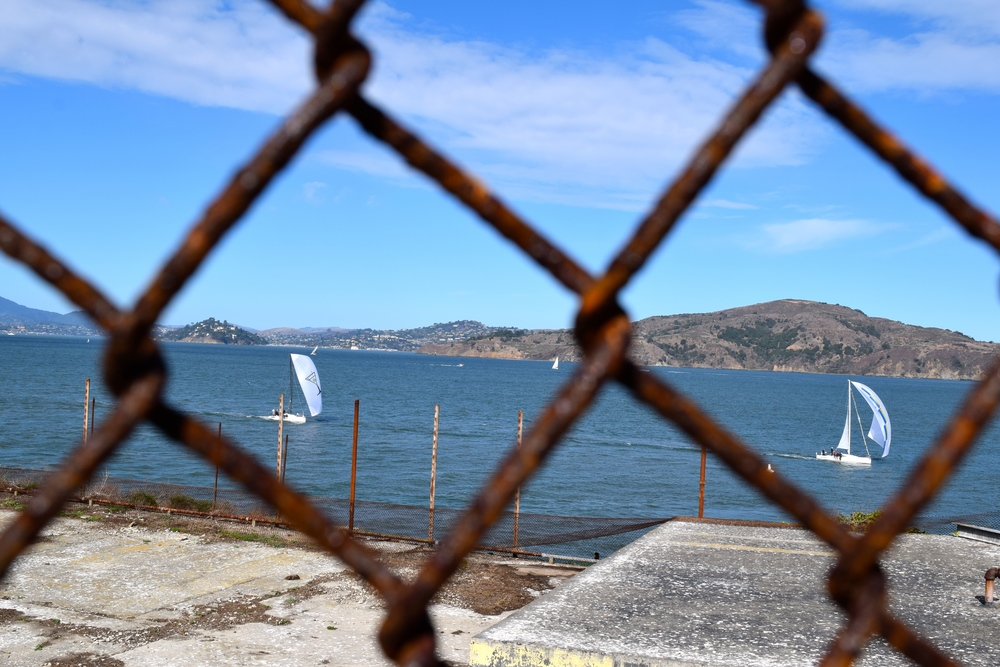 Boats can be seen sailing from the prison yard