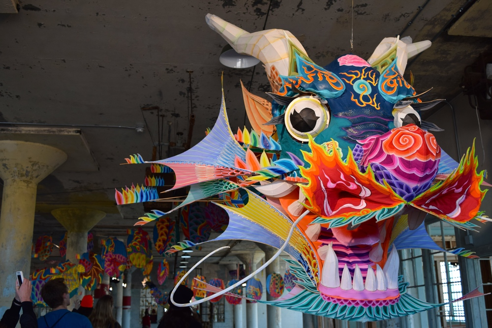 """Piece called With Wind – dragon kite representing personal freedom and also showing a creature who can fly, trapped in a building. The dragon's """"body"""" also had many quotes painted on it"""