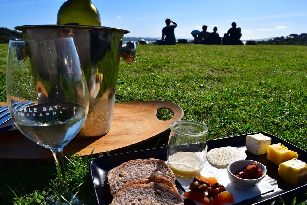 enjoying wine and cheese at Cable Bay Vineyards