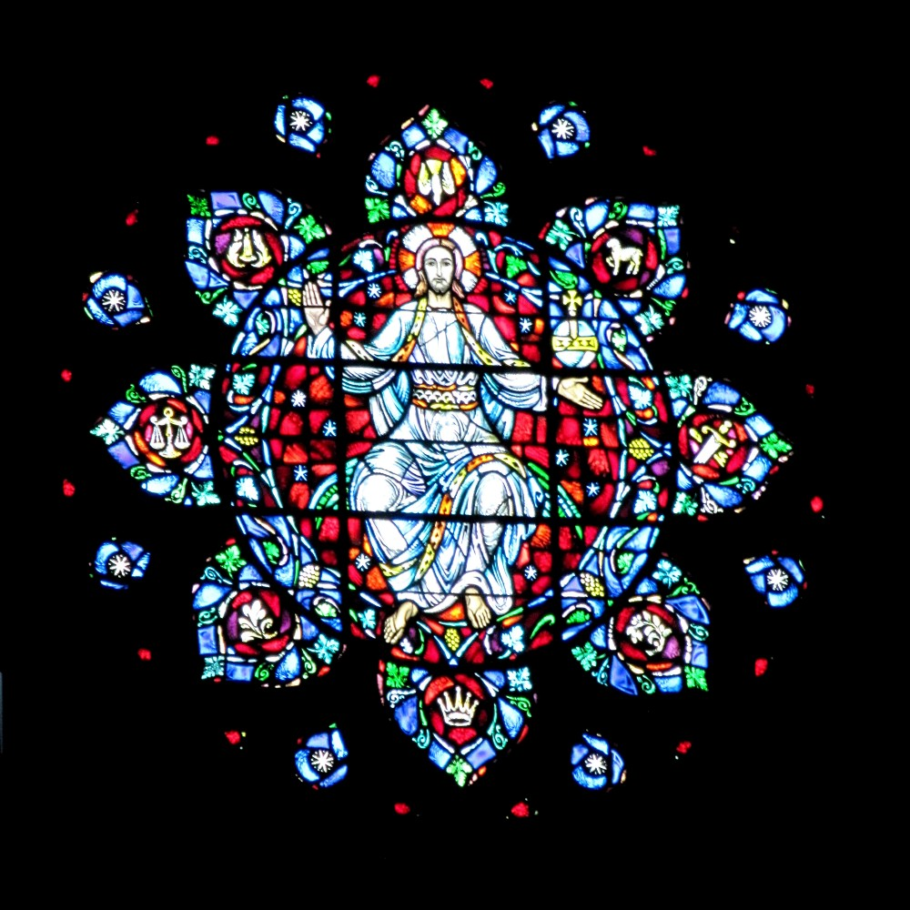 The rose window above at Boston University's Marsh Chapel, where Leary and Alpert administered psilocybin tests on student volunteers. (Wikimedia)