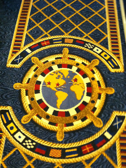 These maps in the carpet help you determine which direction you are walking. If you're facing north, you are walking to the front. See those nautical flags? They spell out the name of the ship in signal flags.