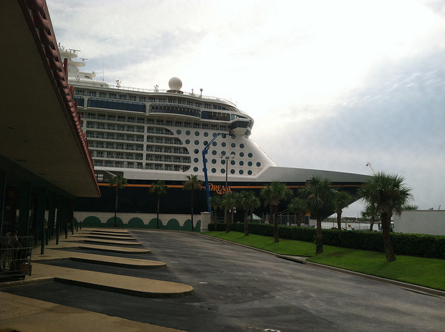 The Disney Dream dwarfs the nearby buildings when in port.