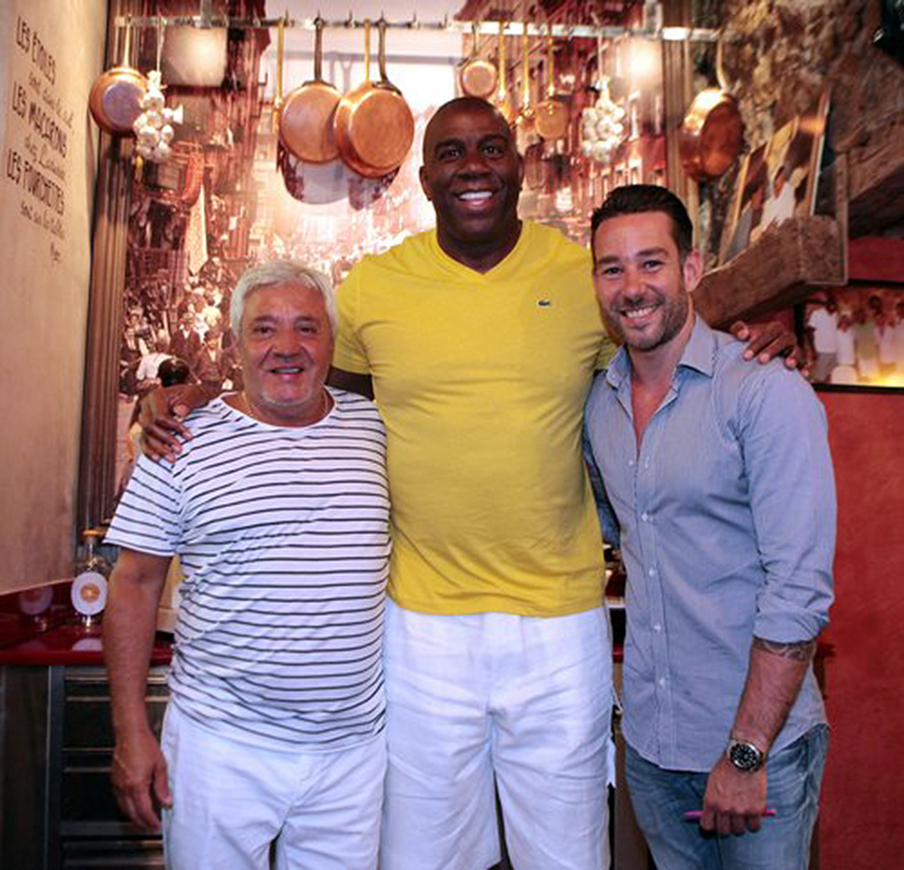 Herve Mamo (left) with one of the biggest fans of MAMO Le Michelangelo, the legendary basketball player Ervin Magic Johnson and Mike Mamo (right)