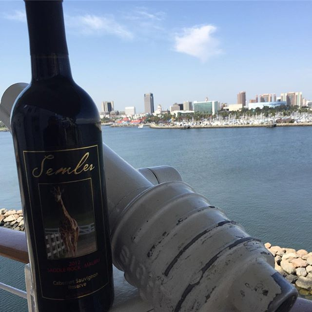 As usual, it's a perfect day here in Long Beach. Our latest release, 2012 Cabernet reserve has just boarded the ship and is now available in the tasting room. This bottle is as good as it gets and features our mascot, @a_giraffe_named_stanley on the label. #malibuwines #queenmary #giraffesareawesome