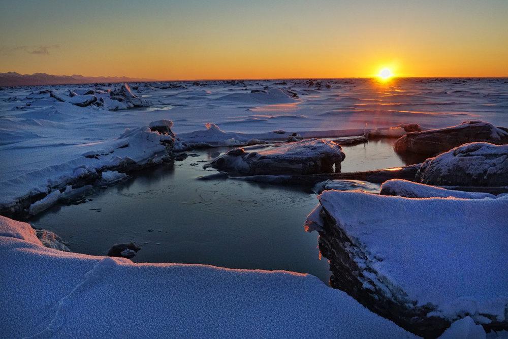 sunset over frozen sea.jpg