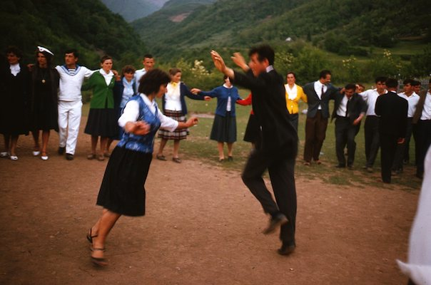 Circle dance with couple doing Eagle Dance in center